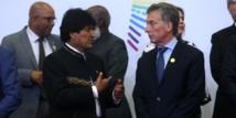 Evo-a la izquierda-y Macri