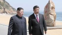 Kim-a la izquierda-y Xi