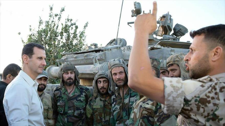 Bashar Al Asad visitando a soldados del ejército